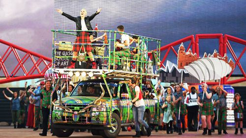 Karen Dunbar sings on top of a kitted-out truck. (Getty)