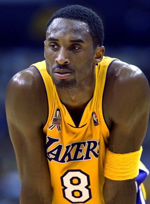 In this 2002 file photo Los Angeles Lakers' Kobe Bryant waits between plays during the opener of their best-of-five first-round Western Conference playoff series against the Portland Trail Blazers in Los Angeles