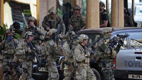 French special forces take up positions outside the Splendid Hotel in Ouagadougou. (AAP)