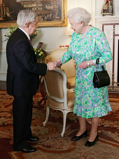 Queen Elizabeth greets Prince Hitachi during a reception for the Praemium Imperiale Awards at Buckingham Palace in central London.