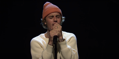 Justin Bieber performs Lonely, his song about childhood fame, on SNL