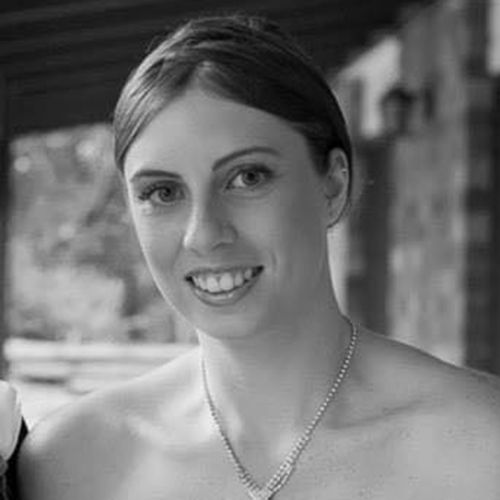 A woman found dead in a Gold Coast backyard with burns to her body has been identified as Kelly Wilkinson.