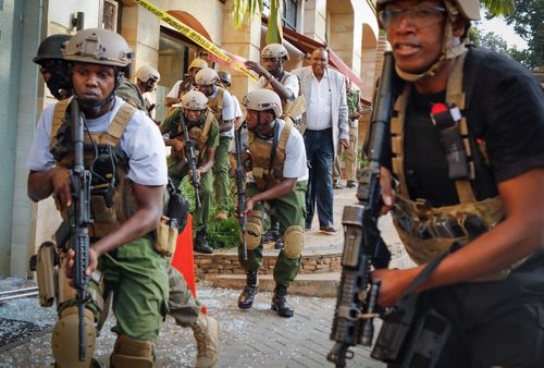 Kenyan security officers search for attackers during the attack on an upmarket hotel in Nairobi.