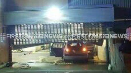The man rammed the car into the underground carpark. (9NEWS)