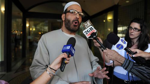 Muslim cleric Man Haron Monis speaks to the media as he leaves the Downing Centre in 2011.