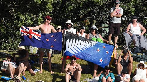 The proposed alternative New Zealand Flag (right) is seen alongside the current flag during a cricket Test match between Australia and New Zealand in Wellington, 2016.