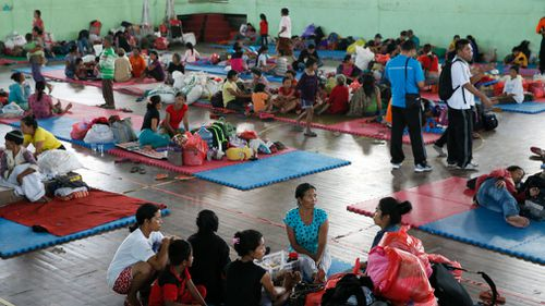 Residents stay at a temporary shelter as they evacuate following increasing seismic activity of Mount Agung in Karangasem, Bali. (AAP)