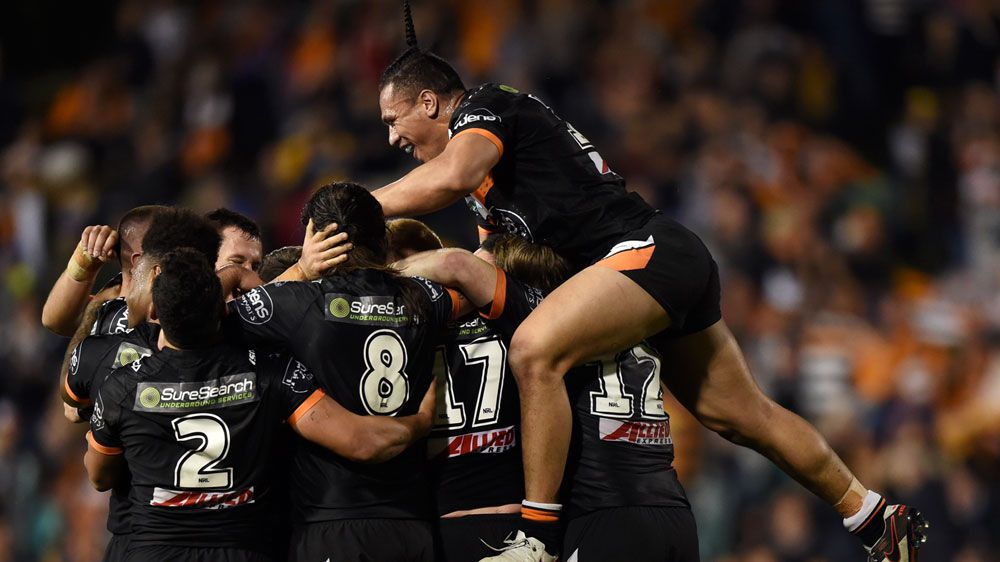 Tigers beat Cowboys to reach NRL top eight