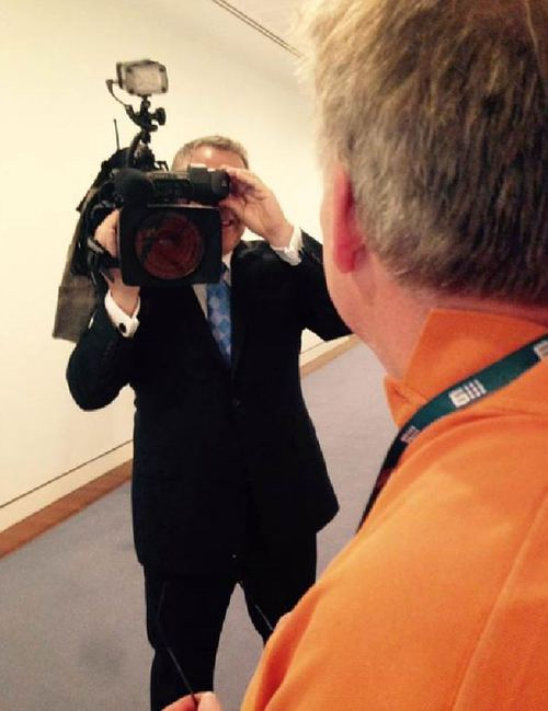 Joe Hockey after taking cameraman Geoffrey Carroll's camera yesterday. (9NEWS)