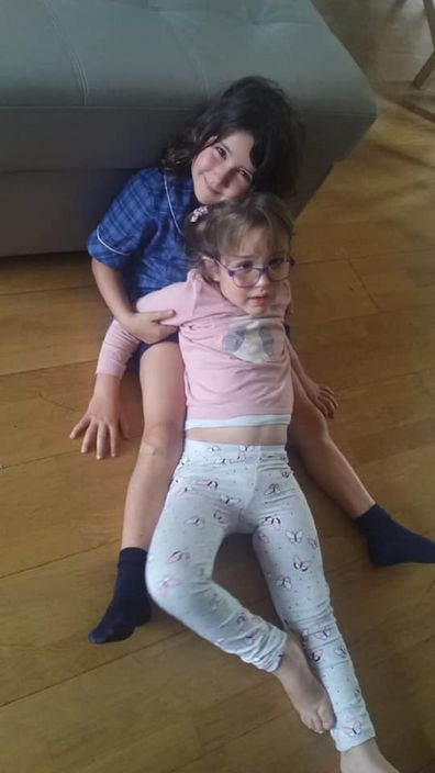 Big sister Erica, eight, with Arianna, five.