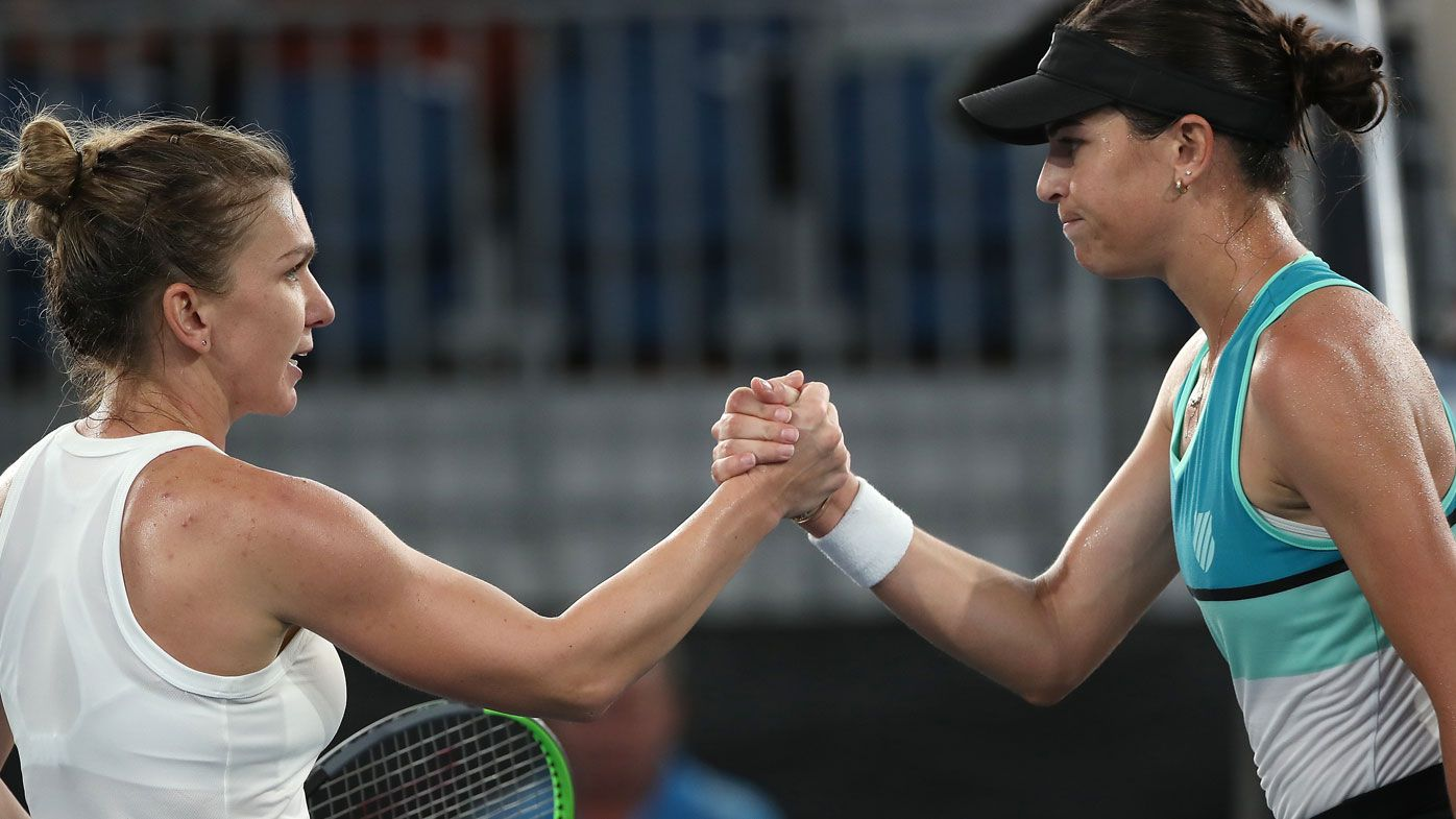 Halep is congratulated by Tomljanovic