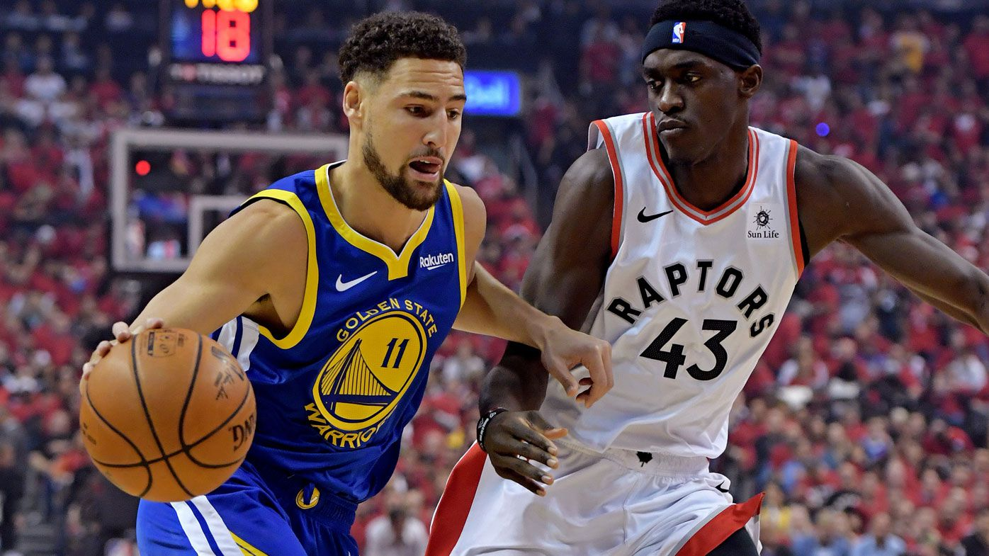 Klay Thompson drives to the basket against Toronto Raptors forward Pascal Siakam