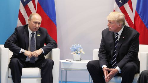 Russian President Vladimir Putin and President of the USA Donald Trump, right, talk during their meeting on the sidelines of the G20 summit in Hamburg. (AFP)