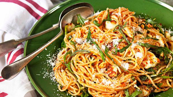 Red pesto spaghetti with rocket and haloumi