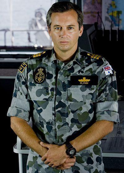 Ian Stenlake as Leiutenant Commander Mike Flynn