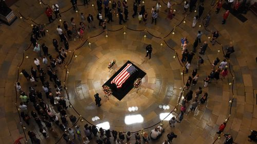 Afterwards thousands of fellow Americans, who had lined up outside the US Capitol in stifling heat, began filing past in the majestic rotunda to say goodbye as McCain lay in state.