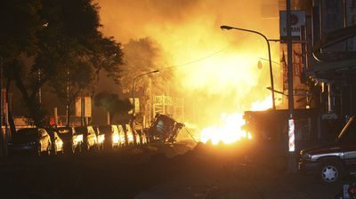 Firefighters battled the blaze in Taiwan until morning. (AAP)