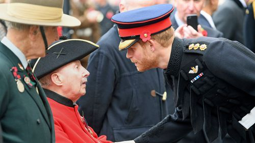 Britain's Prince Harry meets with veterans. (AAP)
