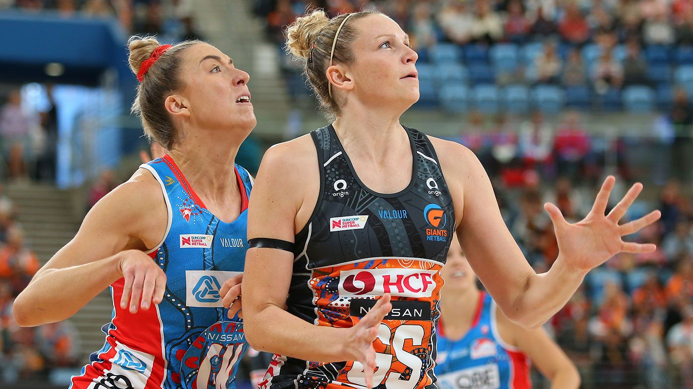 : Sarah Klau of the Swifts and Jo Harten of the Giants compete for the ball during the round six Super Netball match between GWS Giants and Sydney Swifts at Ken Rosewall Arena, on June 06, 2021 in Sydney, Australia. (Photo by Jason McCawley/Getty Images)