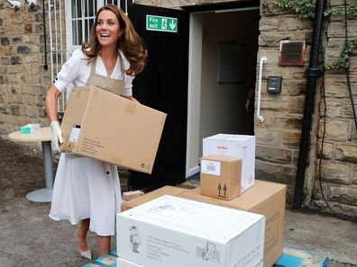 Kate Middleton unloading donations to a baby bank in the UK.