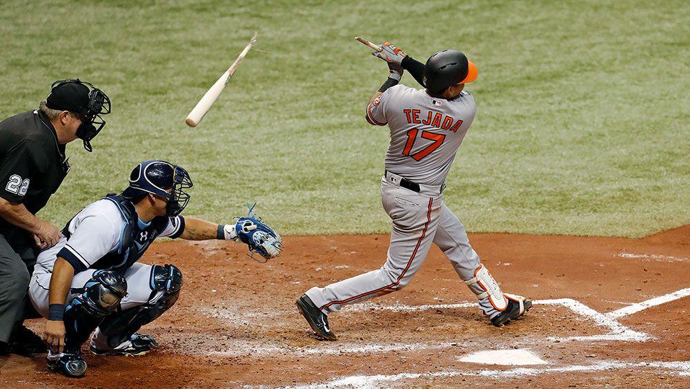 Tampa Bay catcher Wilson Ramos is hit by a broken bat. (AAP)