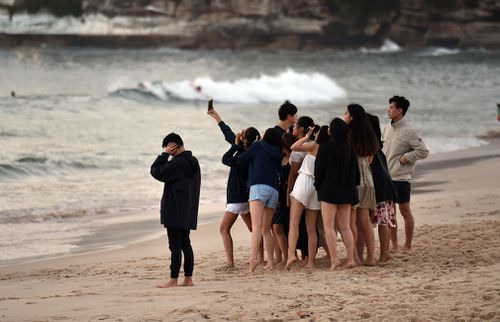 A group poses for a selfie on Bondi.