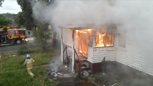 """A 25-year-old man has been arrested after an abandoned home in Melbourne's east was badly damaged by a """"suspicious"""" blaze."""
