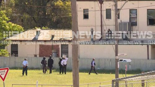 Negotiators are trying to talk the man into coming down from the hotel roof. (9NEWS)