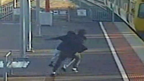 An Adelaide man tried to push his teenage girlfriend in front of a moving train.