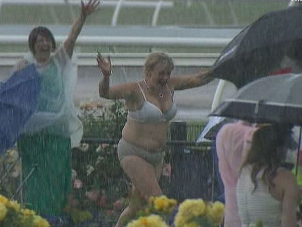 Woman strips off for underwear run at sodden Ladies Day