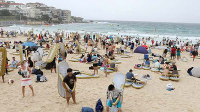 An unusually cool Sydney day didn't keep the crowds away from Bondi beach. (AAP)