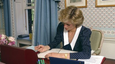 Princess Diana writing at her home in Kensington Palace, 1985