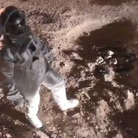 Indian astronaut moonwalks down pothole-covered street