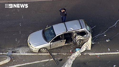 The woman travelling in the car died at the scene. (9NEWS)