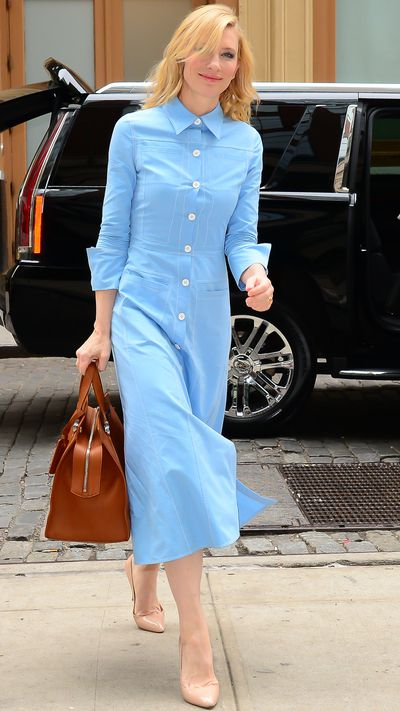 In a powder blue <strong>Derek Lam</strong> dress.