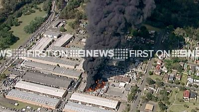 Smoke billows over Sydney's west as a fire demolishes a waste management centre. (9NEWS)