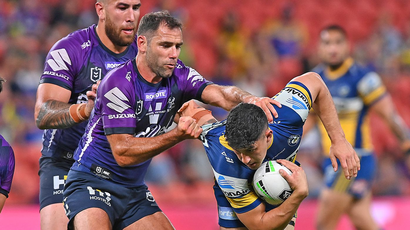 Dylan Brown of the Eels is tackled by Cameron Smith of the Storm