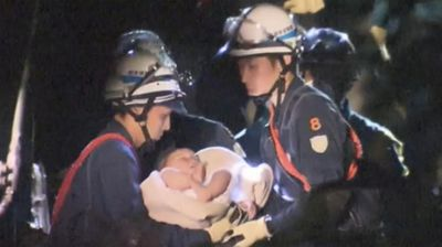 Amid the devastation, baby Miku, who is nine months old, was pulled from the wreckage of a building and tenderly passed from rescuer to rescuer.