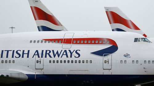 British Airways planes are parked at Heathrow Airport in London