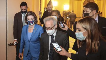 House Speaker Nancy Pelosi leaves the House chamber after successfully averting a government shutdown.