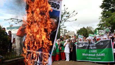 "January 15, 2015: Around 1,500 people protested in one of the Philippines' main Muslim-majority cities on Wednesday against the French satirical weekly Charlie Hebdo's caricatures of the Prophet Mohammed, police said.<br><br> Local politicians, teenaged students and women with veils covering their faces packed the main square in Marawi in the southern Philippines, some raising their fists in the air as a Charlie Hebdo poster was burnt.<br><br>""What had happened in France, the Charlie Hebdo killing, is a moral lesson for the world to respect any kind of religion, especially the religion of Islam,"" organisers said in a statement released during the three-hour rally. <br><br>""Freedom of expression does not extend to insulting the noble and the greatest prophet of Allah.""<br><br>A group calling itself ""Boses ng Masa"", or Voice of the Masses organised the rally, which attracted about 1,500 people, Marawi police officer Esmail Biso told AFP.<br><br>He said non-government organisations and a local school owner were behind the group.<br><br> Photo by Getty Images."