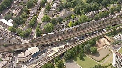 Three people killed by train in south London