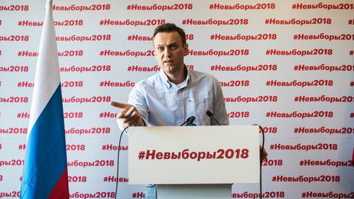 Russian liberal opposition leader and a head of an anti-corruption foundation, Alexei Navalny, calls on the public to ignore president elections. (AAP)
