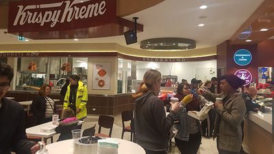 "Those willing to brave the storm flocked to Krispy Kreme, the ""only place open in West Adelaide"". (Twitter/@cottonring)"