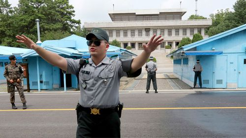 A file photograph shows a South Korea army soldier gestures at the border villages of Panmunjom in Paju. (AAP)