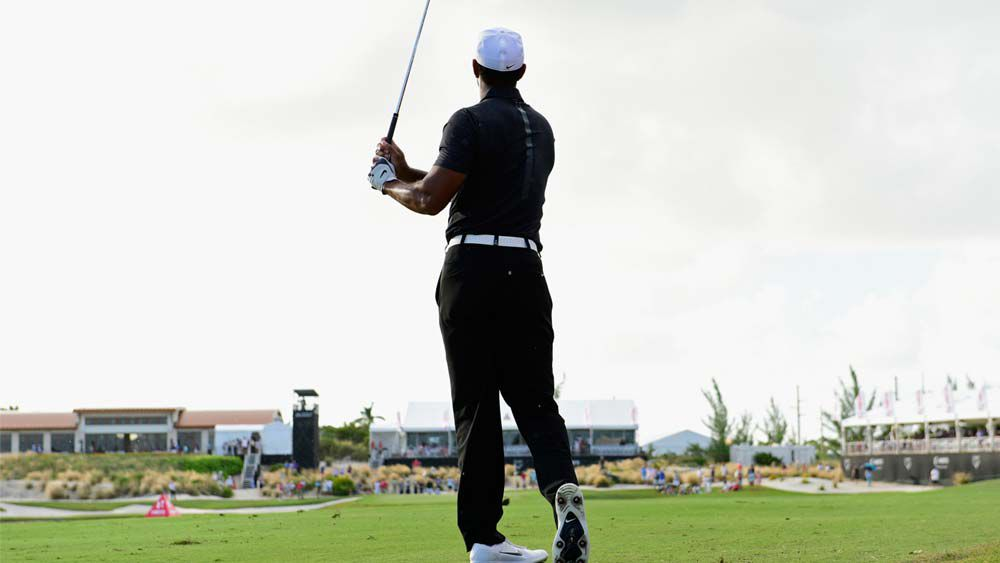 Tiger Woods happy after encouraging return
