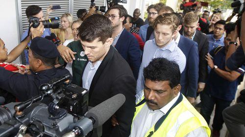 The nine were met by a waiting media scrum. (AAP)