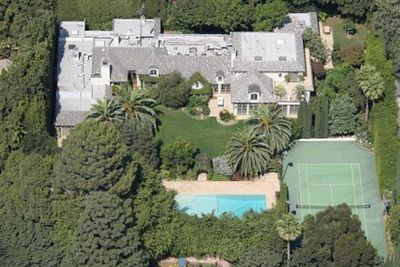 This Beverly Hills beauty belonged to none other than the Queen of pop herself, <b>Maddona</b>, and ex husband, <b>Guy Ritchie</b>. The couple bought the home in 2003 for $12 million, which gave them 5800 square feet of space, three bedrooms, five bathrooms, a tennis court, pool, games room and even a British-style pub (we're guessing that was Guy's little indulgence). The couple sold the house when they split after nearly 8 years of marriage, for $20 million in 2008.