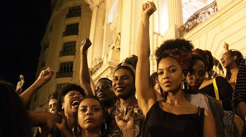 Hundreds rallied outside the Legislative Assembly in Rio de Janeiro. (AAP)