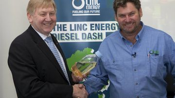 Minister for Resources and Energy, Martin Ferguson (left) and Mr Peter Bond, CEO and founder of Linc Energy shake hands at an event in Canberra in 2011. Picture: AAP